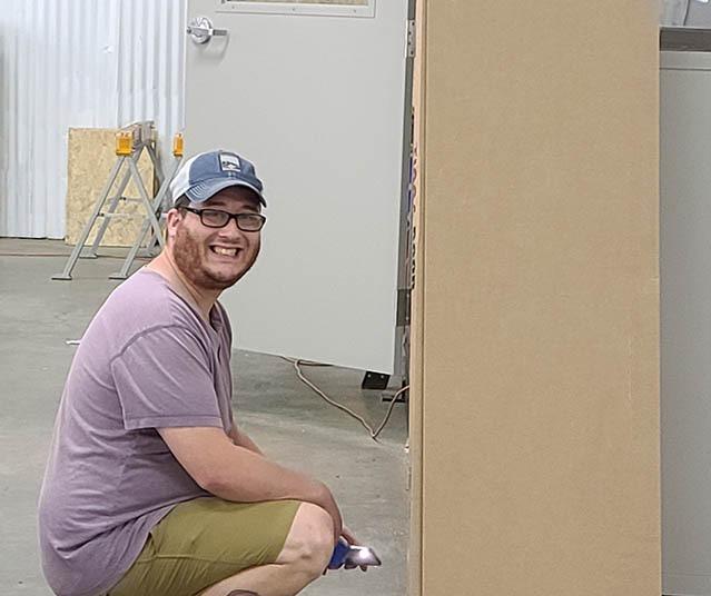 Matthew Inspecting a Building