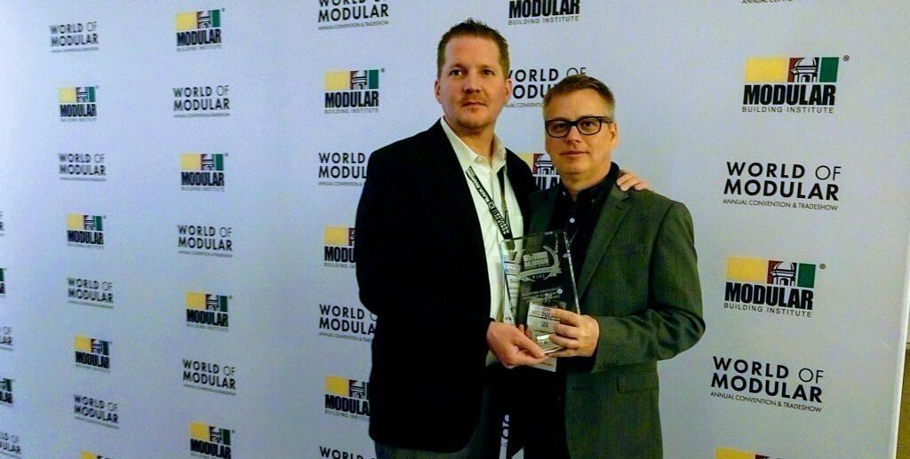 Lee & Isaiah with Award